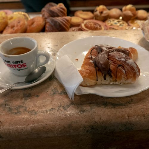Italian breakfast - espress0o and pastry while standing at counter